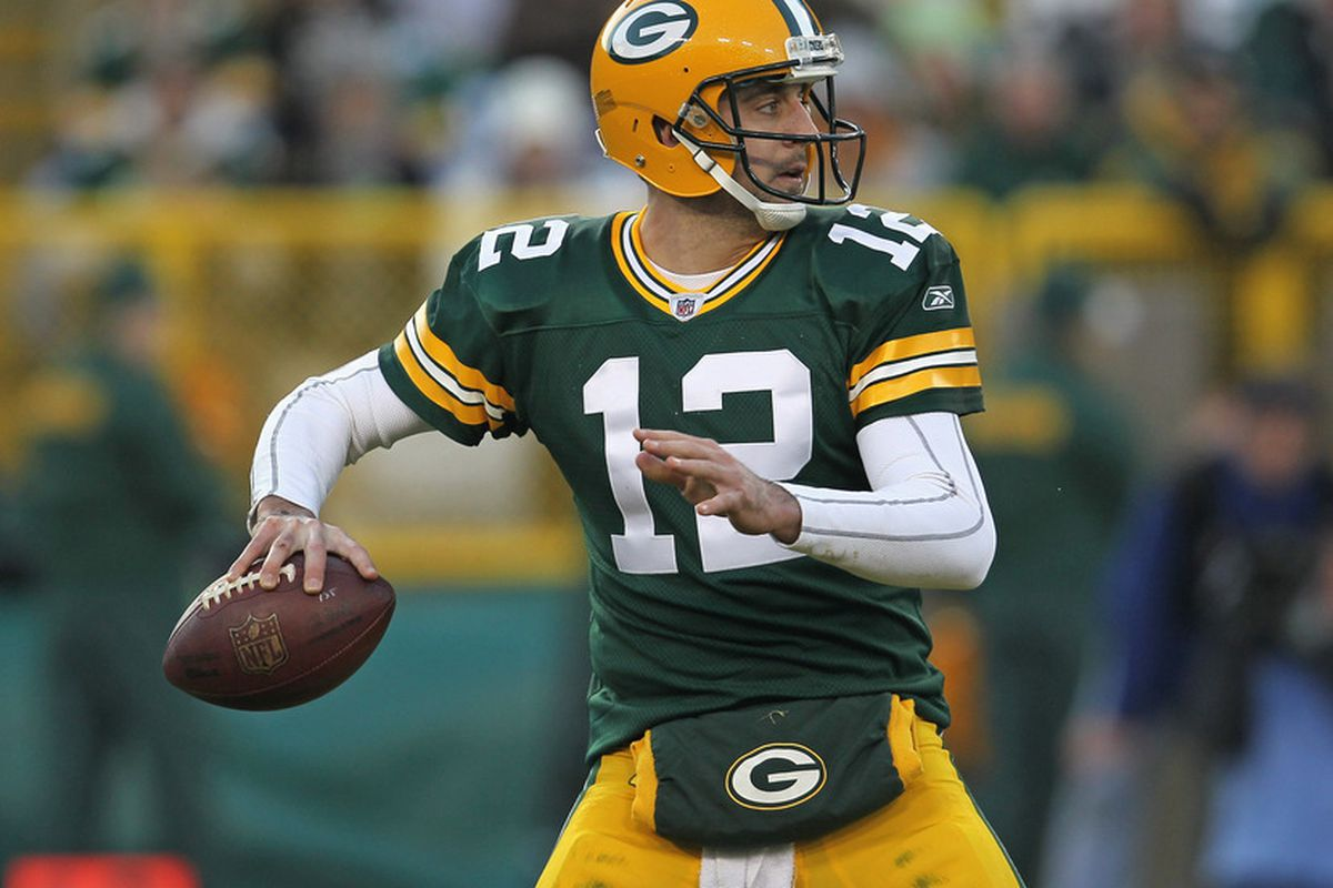 GREEN BAY, WI - DECEMBER 11: Aaron Rodgers #12 of the Green Bay Packers throws a pass against the Oakland Raiders at Lambeau Field on December 11, 2011 in Green Bay, Wisconsin. (Photo by Jonathan Daniel/Getty Images)
