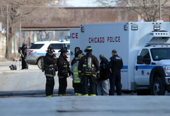 Police and fire department officials report to a call of grenades in a vehicle in the 600 block of West 59th. | Brian Jackson