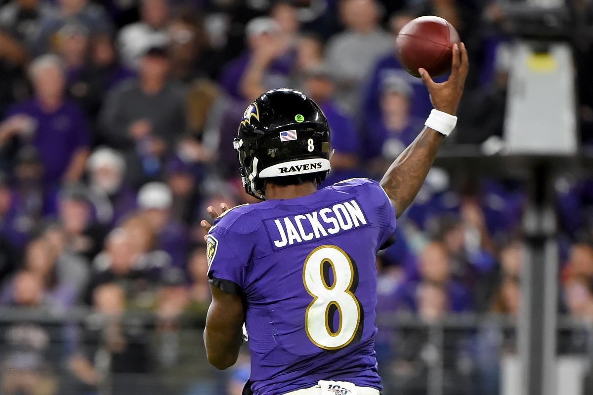 Lamar Jackson of the Baltimore Ravens throws against the Tennessee Titans during the AFC Divisional Playoff game at M&T Bank Stadium on January 11, 2020 in Baltimore, Maryland.