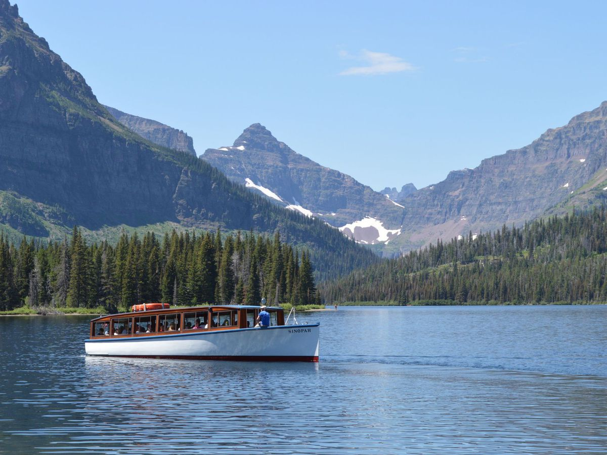 The Glacier Park Boat Company is a great way to tour the park's waterways, including Two Medicine (pictured). | NPS/Tim Rains