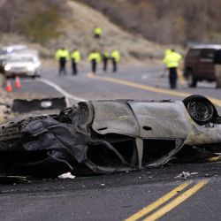 Woman killed in fiery rollover crash - Deseret News