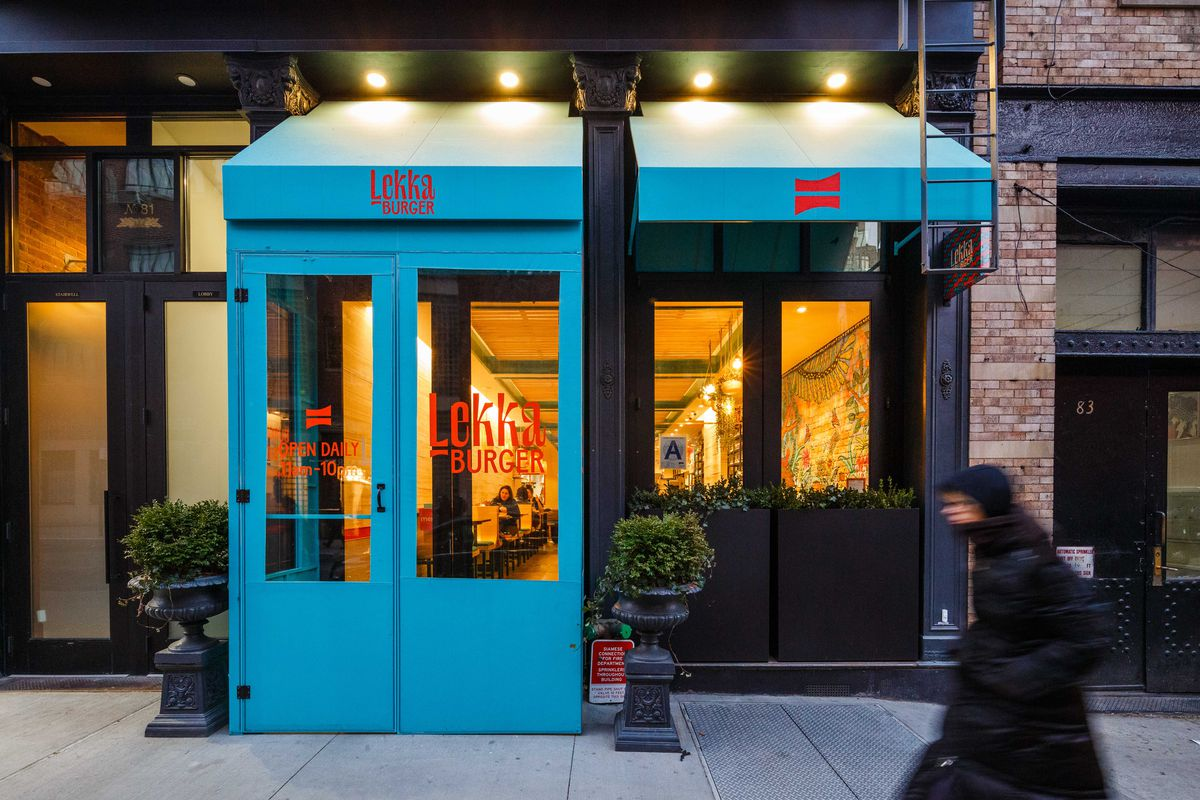 A sea blue awning stands before the entrance to Lekka Burger