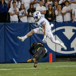 Brigham Young fullback Masen Wake, top, dodges a tackle by Arizona State wide receiver Giovanni Sanders (20) during an NCAA college football game at LaVell Edwards Stadium in Provo on Saturday, Sept. 18, 2021.