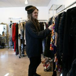 Joey looks for holiday-ready pieces to pull for the exhibit at Marie's showroom.