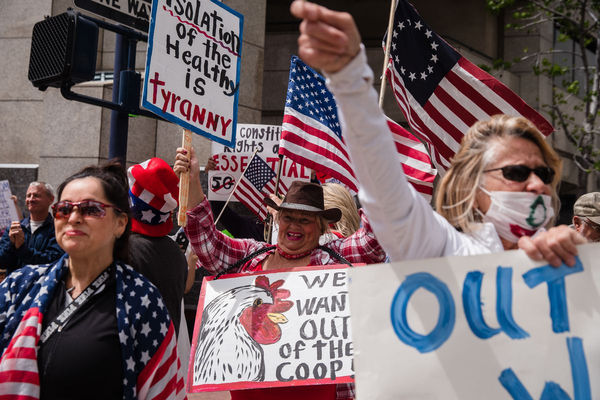 Protesters rally in downtown San Diego against California's stay at home order to prevent the spread of the novel coronavirus, which causes COVID-19, on April 18, 2020. -