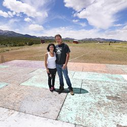 Studio Ranch owners Lynnie and Jason Manning stand on the stage of the Amphitheater at Studio Ranch in Tooele County on Thursday, May 21, 2020. A controversial outdoor concert planned by Utah Business Revival is being moved from Kaysville, but a Tooele County official says it's news to him.