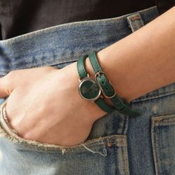 "<b>Assembly x Neji Commu</b> Leather Wrap Wristwatch in green, <a href=""http://assemblynewyork.com/assembly-x-neji-commu-leather-wrap-wristwatch-green.html"">$328</a> at Assembly New York"