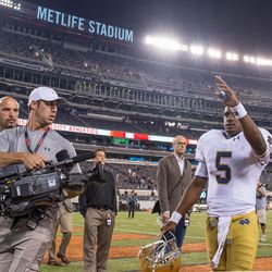 Golson waves to fans after the Irish win