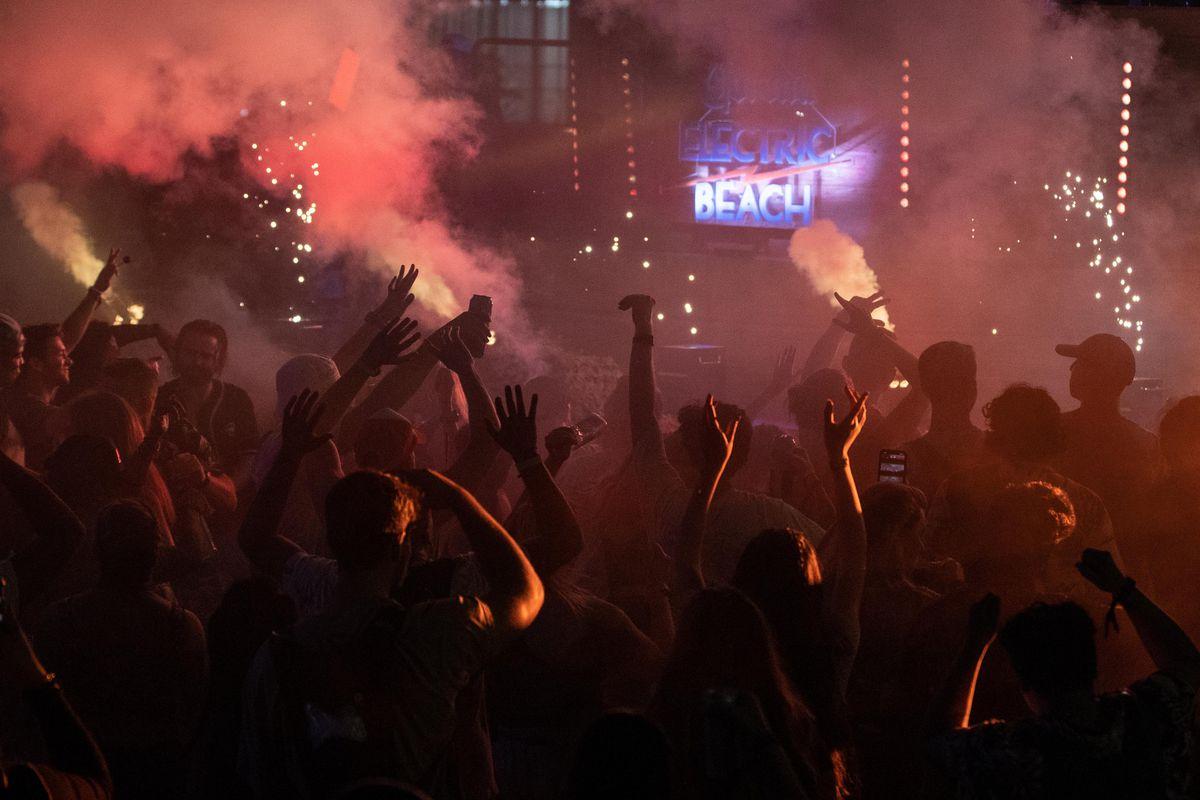 Festival goers dance as Nostalgix performs Saturday.
