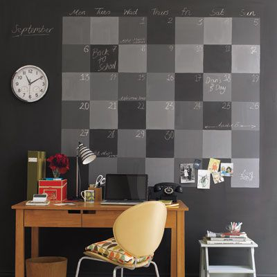 A black wall with a checkered calendar drawn onto it.