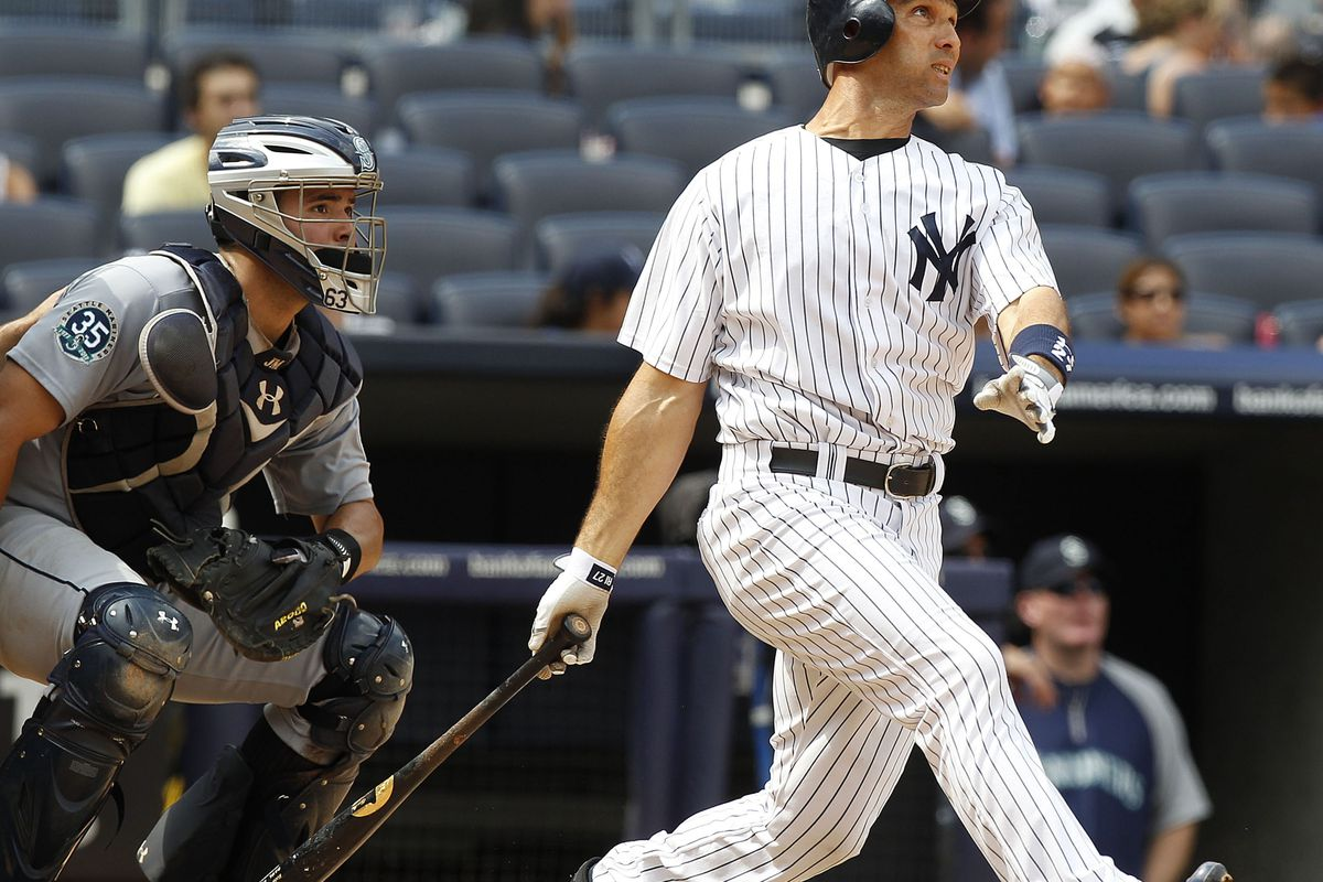 Aug 5, 2012; Bronx, NY, USA; New York Yankees left fielder Raul Ibanez (27) hits a 5th inning homer against the Seattle Mariners at Yankee Stadium. Mandatory Credit: William Perlman/THE STAR-LEDGER via US PRESSWIRE