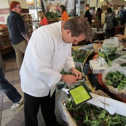 Chef Brian Howard checks out the produce at the Downtown 3rd Farmers Market.
