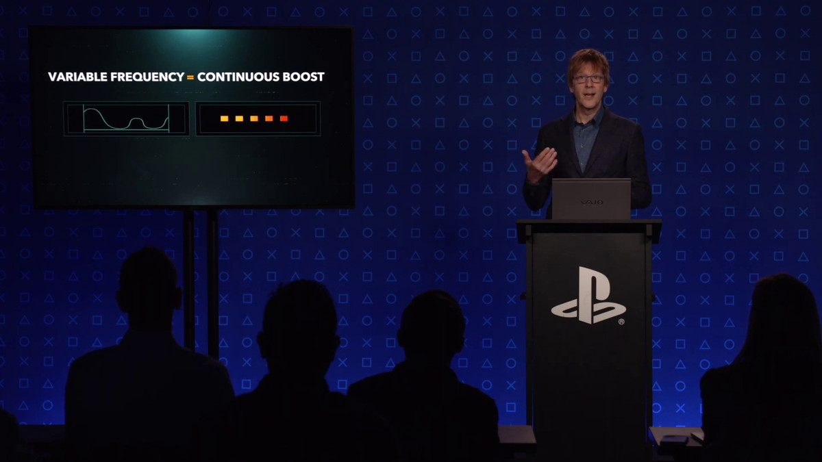 Mark Cerny standing behind a PlayStation-branded podium giving a presentation on the PS5 hardware specifications