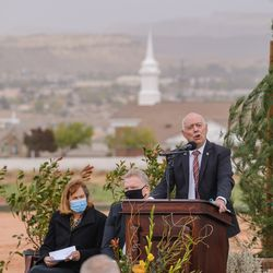 David T. Hinton delivers a testimony at the groundbreaking service for the Red Cliffs Utah Temple of The Church of Jesus Christ of Latter-day Saints in St. George, Utah, Saturday, Nov. 7, 2020. Hinton is flanked by, from left, Sister Debbie Christensen, and Elder Craig C. Christensen, Utah Area president.