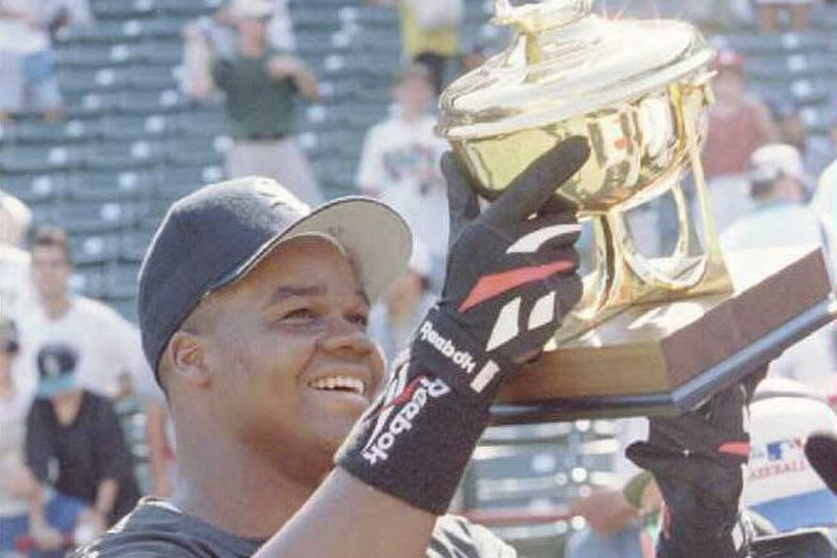 Frank Thomas of the Chicago White Sox hoists his t