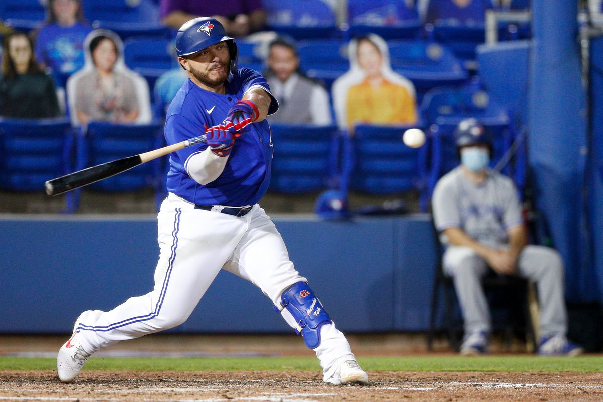 Toronto Blue Jays catcher Alejandro Kirk (30) hits a two-run home run in the fourth inning against the Atlanta Braves at TD Ballpark.