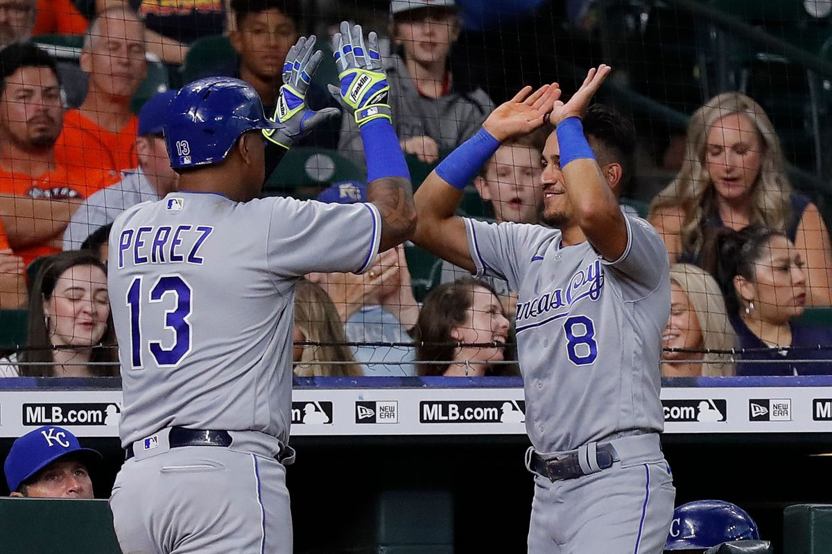 Salvador Perez #13 of the Kansas City Royals receives a high five from Nicky Lopez #8 after hitting a home run in the third inning against the Houston Astros at Minute Maid Park on August 23, 2021 in Houston, Texas.