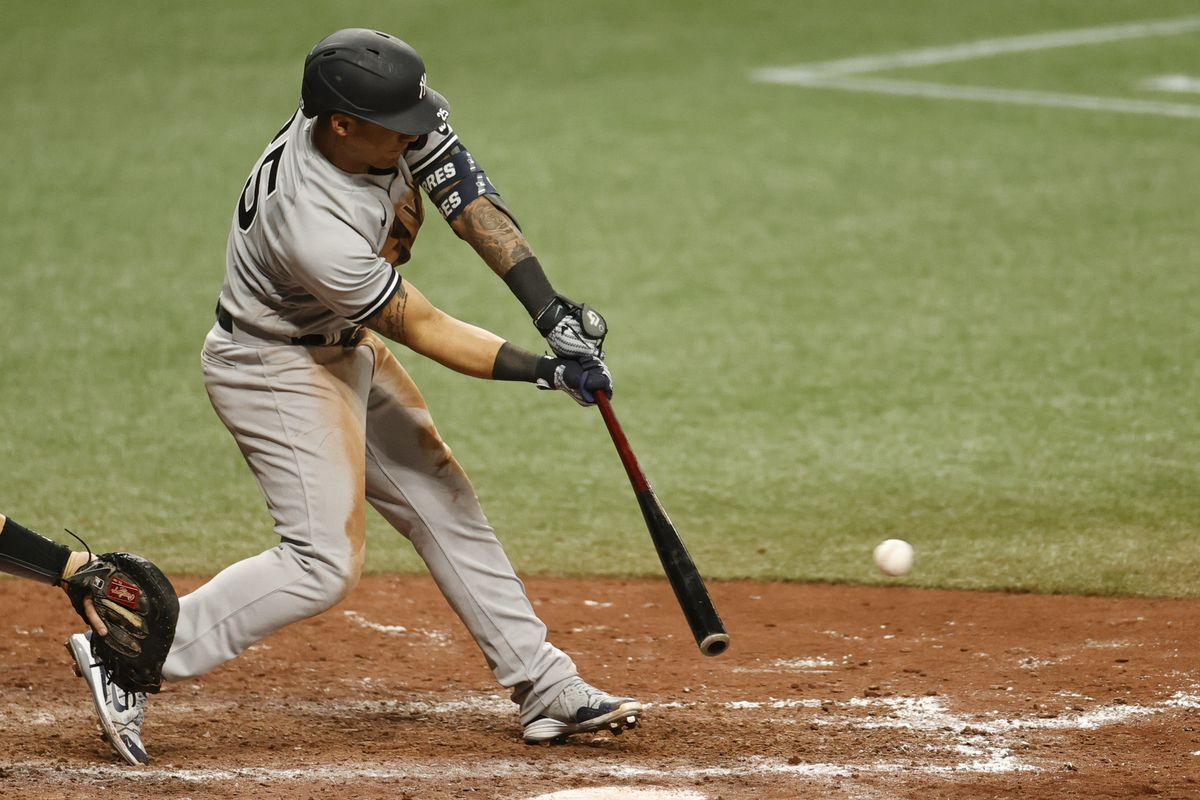 Gleyber Torres #25 of the New York Yankees grounds into a fielders choice during the tenth inning against the Tampa Bay Rays at Tropicana Field on April 11, 2021 in St Petersburg, Florida.