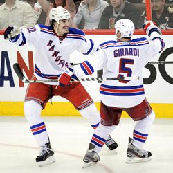 New York Rangers' Brian Boyle, left, skates towards teammate Dan Girardi as he celebrates his game winning goal against the Ottawa Senators during the third period of game three of first round NHL Stanley Cup playoff hockey action at the Scotiabank Place in Ottawa on Monday, April 16, 2012. The Rangers defeated the Senators 1-0. (AP Photo/The Canadian Press, Sean Kilpatrick)