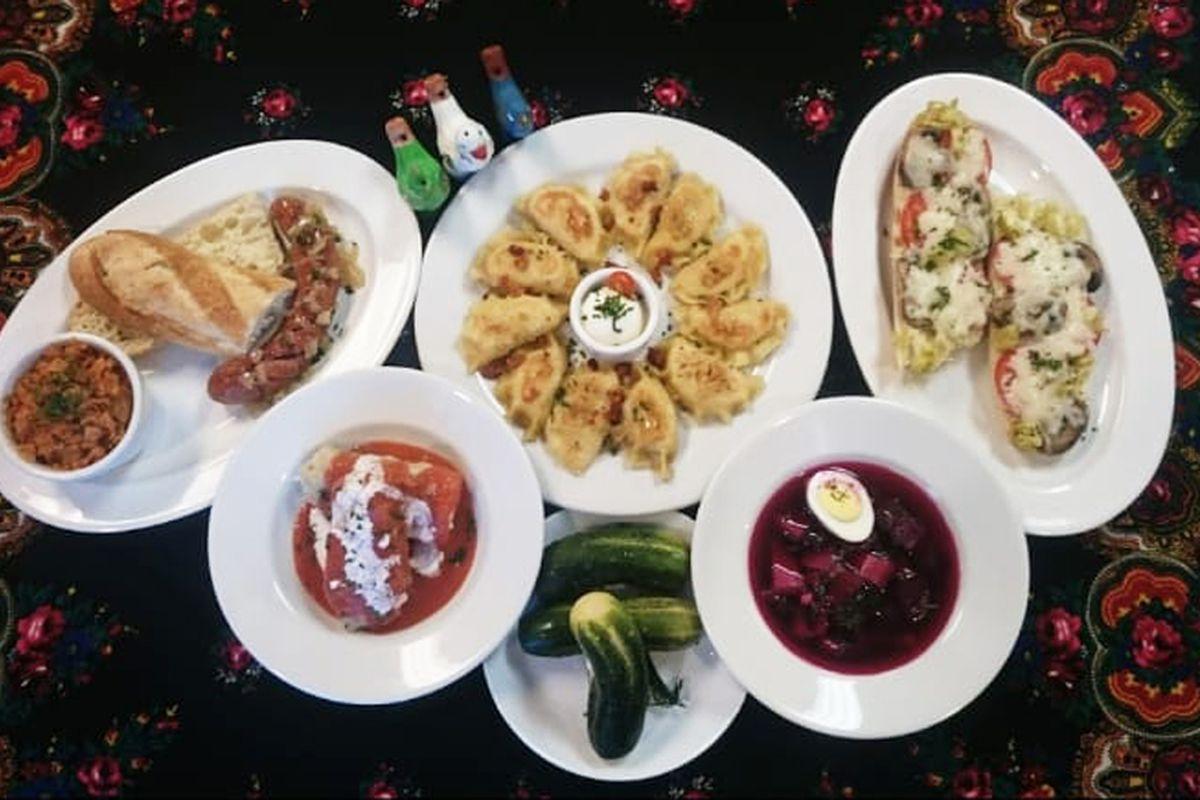 Plates of pierogis, Polish sausage, an open face sandwich and botszacz soup at the future Pierogi Village.
