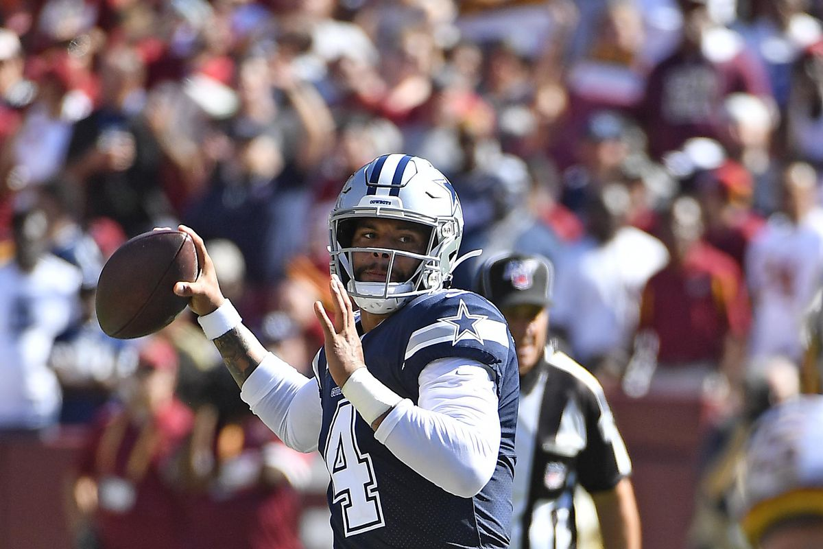 Dallas Cowboys quarterback Dak Prescott attempts a pass against Washington during the second half at FedExField.