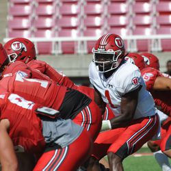 Utah quarterback Tyler Huntley takes a snap during the Utes' scrimmage at Rice-Eccles Stadium on Saturday, Aug. 17, 2019.