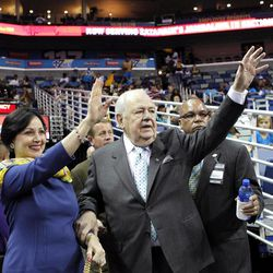 Tom Benson, New Orleans Saints owner, waves to the crowd with his wife, Gayle Benson, as he arrives for an NBA basketball game between the New Orleans Hornets and the Memphis Grizzlies in New Orleans, Sunday, April 15, 2012. Benson agreed Friday to purchase the Hornets from the NBA.