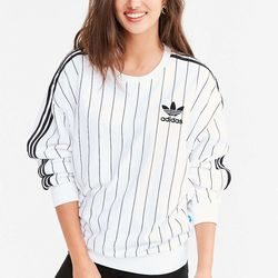 This retro Adidas pullover works as well with a flouncy white skirt as it does with boyfriend jeans or cut-off shorts.