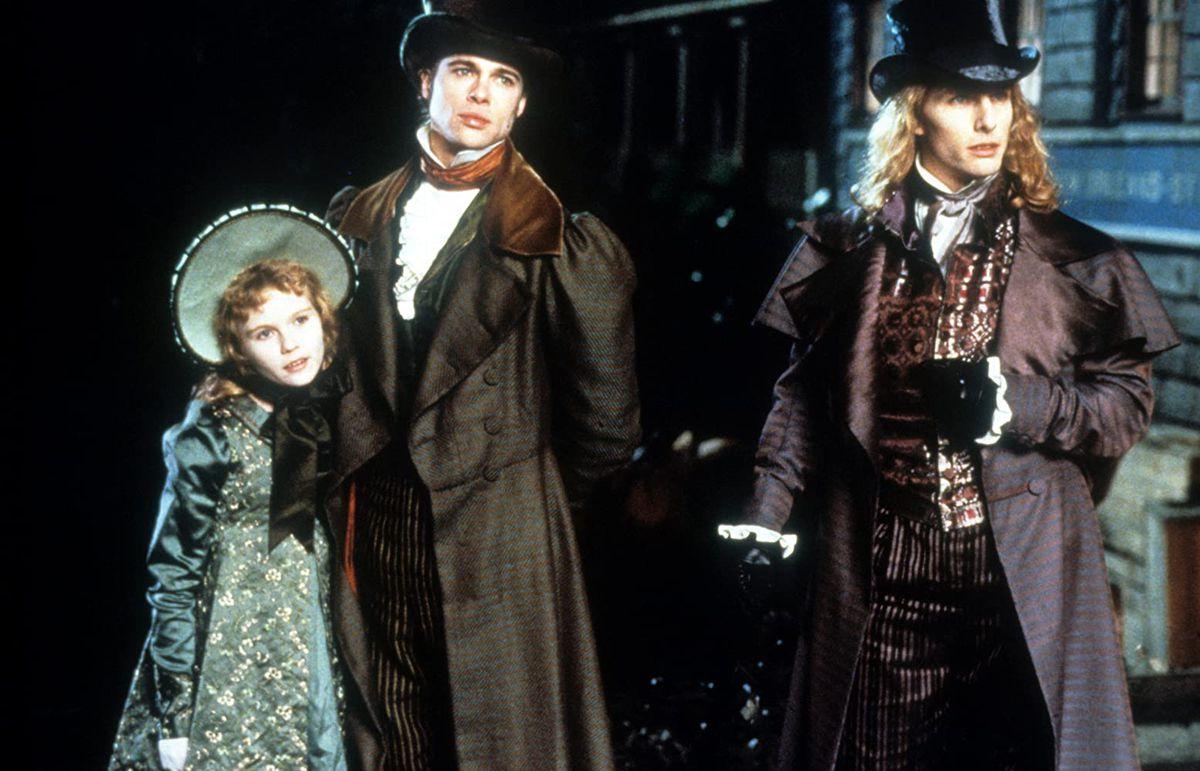 Lestat (Tom Cruise), Louis (Brad Pitt), and Claudia (Kirsten Dunst) wearing period costume
