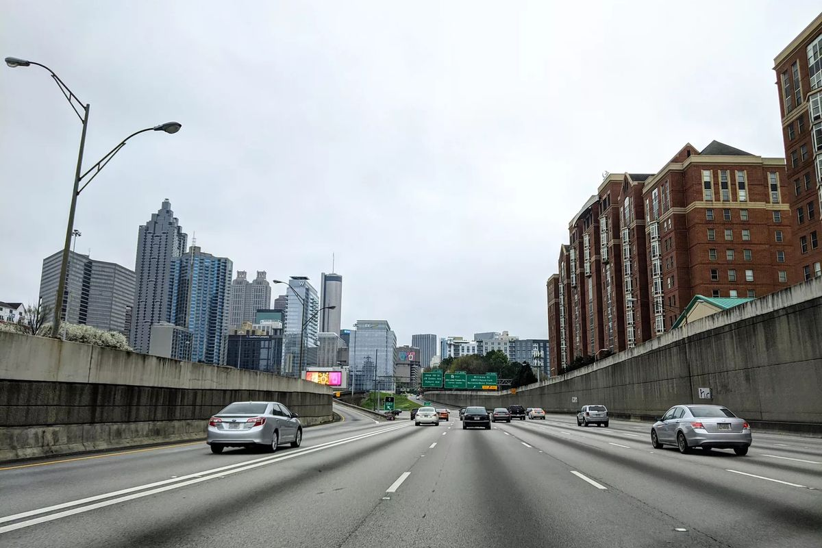 Hardly any traffic on Atlanta's Downtown Connector, with Georgia Tech buildings to the right and Midtown and downtown high-rises to the left.