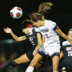 BYU Taylor Campbell Isom (2) tries to head the ball into the goal around UNLV Dakota Blazak (13) as BYU and UNLV play in the first round of the NCAA tournament in Provo on Friday, Nov. 11, 2016.