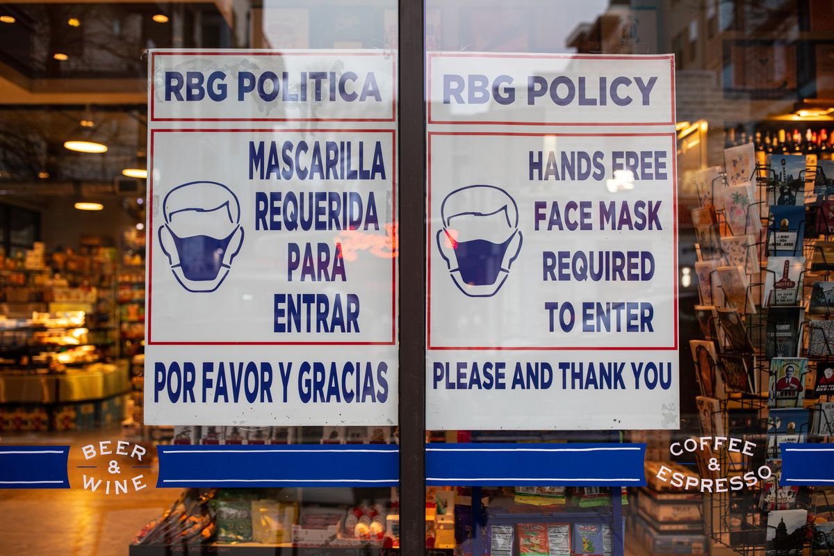 Face mask signage at a location of Royal Blue Grocery