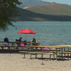 Families have fun at Bear Lake in Rich County on Monday, June 5, 2017. The water levels are high, so there is limited parking and limited beaches. That means those who want to enjoy the beach and the water will need to arrive early to make sure they have a parking space.