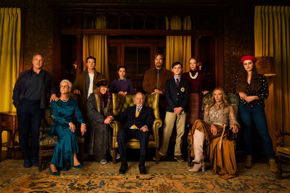A family portrait set against elegant surroundings.