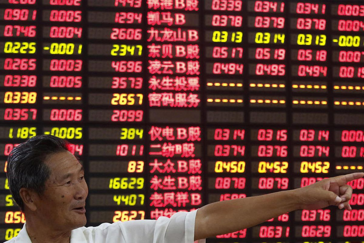 An investor gestures in front of the stock price monitor at a private securities company in Shanghai, China, Wednesday Sept. 5, 2012. Weaker-than-expected U.S. manufacturing figures, just days after China announced its own production slowdown, sent Asian
