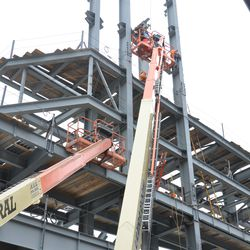 Girder being lowered into the jumbotron structure -
