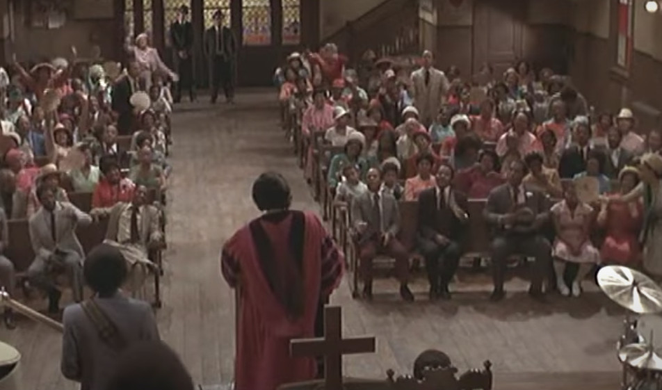 "Reverend Cleophus James (James Brown) leads the congregation in ""The Old Landmark"" during Sunday services at Triple Rock Church (Pilgrim Baptist Church in Chicago) in a scene from ""The Blues Brothers."""