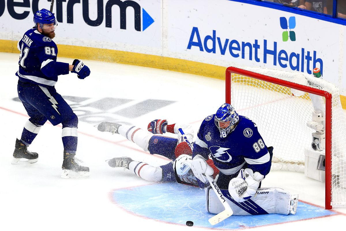 Andrei Vasilevskiy #88 of the Tampa Bay Lightning makes the save against Josh Anderson #17 of the Montreal Canadiens as Anderson crashes into the net under pressure from Erik Cernak #81 during the third period in Game Five of the 2021 NHL Stanley Cup Final at Amalie Arena on July 07, 2021 in Tampa, Florida.