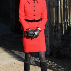 Dressed in a red skirt suit and Aquatalia by Marvin K. boots and gloves during a visit to her alma mater, the University of St Andrews, on February 25th, 2011.