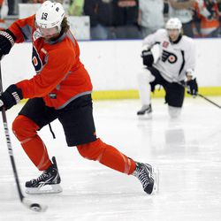 Philadelphia Flyers left wing Scott Hartnell shoots during NHL hockey practice in Voorhees, N.J., Tuesday, April 17, 2012. The Flyers host the Pittsburgh Penguins in Game 4 of a first round Stanley Cup playoffs series on Wednesday. The Flyers lead the best-of-seven games series 3-0.