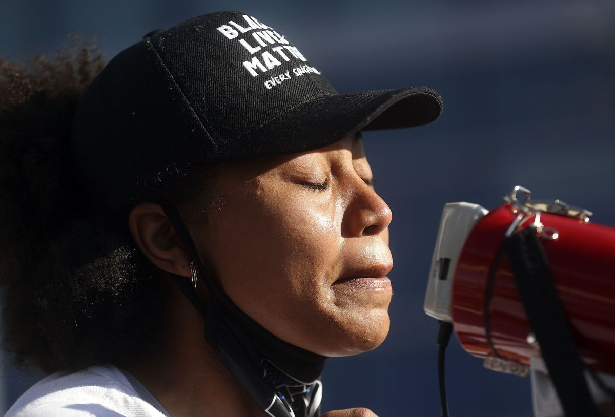 A tear streams down Rae Duckworth's cheek as she speaks during a rally in front of the Salt Lake City Public Safety Building after a jury found former Minneapolis police officer Derek Chauvin guilty in the killing of George Floyd on Tuesday, April 20, 2021.