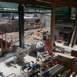 """5:38 p.m. The new west gate from the new """"plaza"""" (triangle lot), still under construction -"""