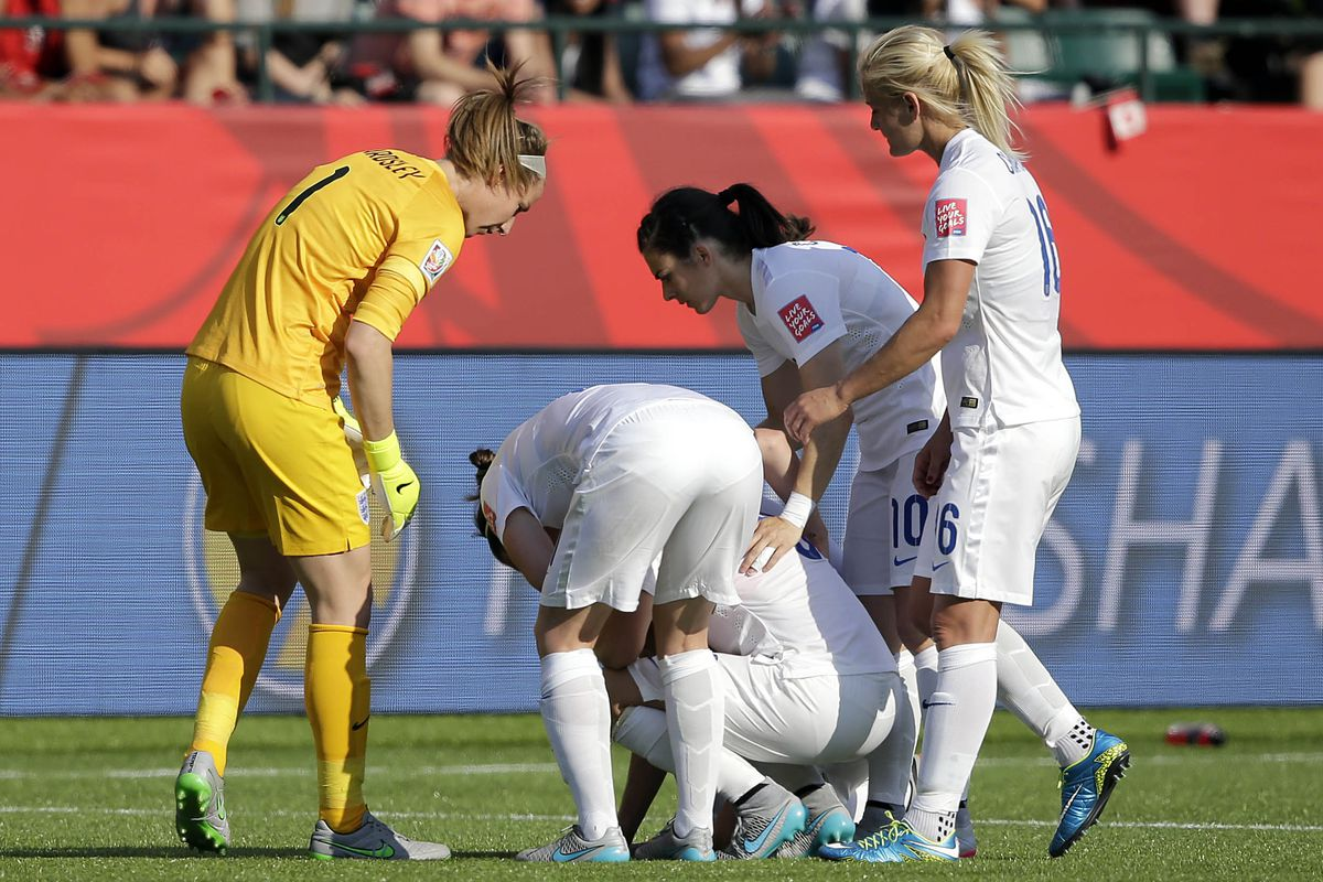 Laura Bassett consoled by her England team mates after losing their World Cup semi-final match.