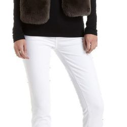 """<strong>Barneys New York CO-OP</strong> Faux Fur Vest, <a href=""""http://www.barneys.com/Barneys-New-York-CO-OP-Faux-Fur-Vest/502071505,default,pd.html?q=faux&index=21"""">$255</a>"""