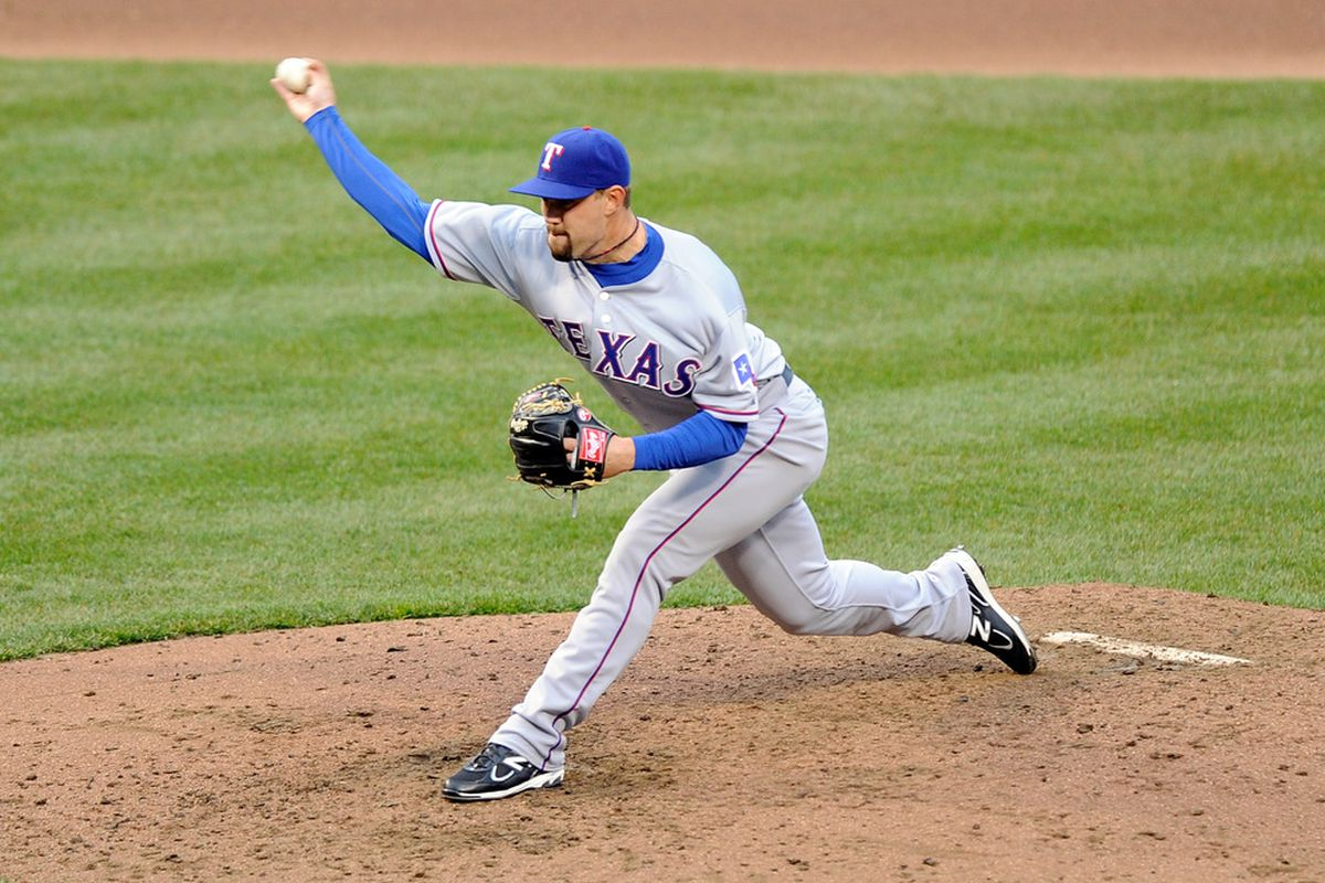 BALTIMORE, MD - APRIL 09:  Mason Tobin #55 of the Texas Rangers pitches against the Baltimore Orioles at Oriole Park at Camden Yards on April 9, 2011 in Baltimore, Maryland.  (Photo by Greg Fiume/Getty Images)