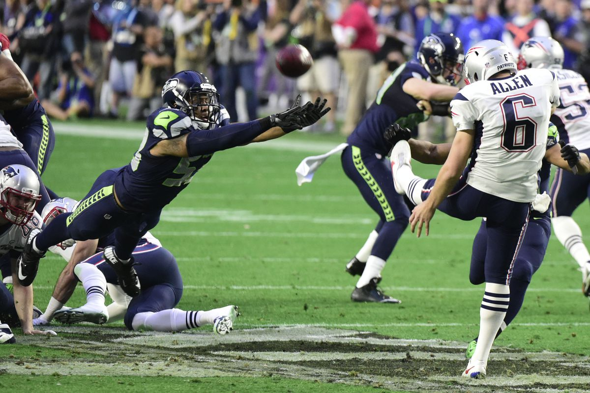 Ryan Allen gets off a punt for New England against the Seahawks in Super Bowl XLIX.