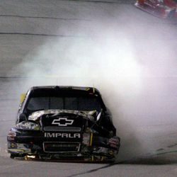 Ryan Newman (39) brings his car into the pits after it caught fire during the NASCAR Sprint Cup Series auto race at Atlanta Motor Speedway, Sunday, Sept. 2, 2012, in Hampton, Ga.