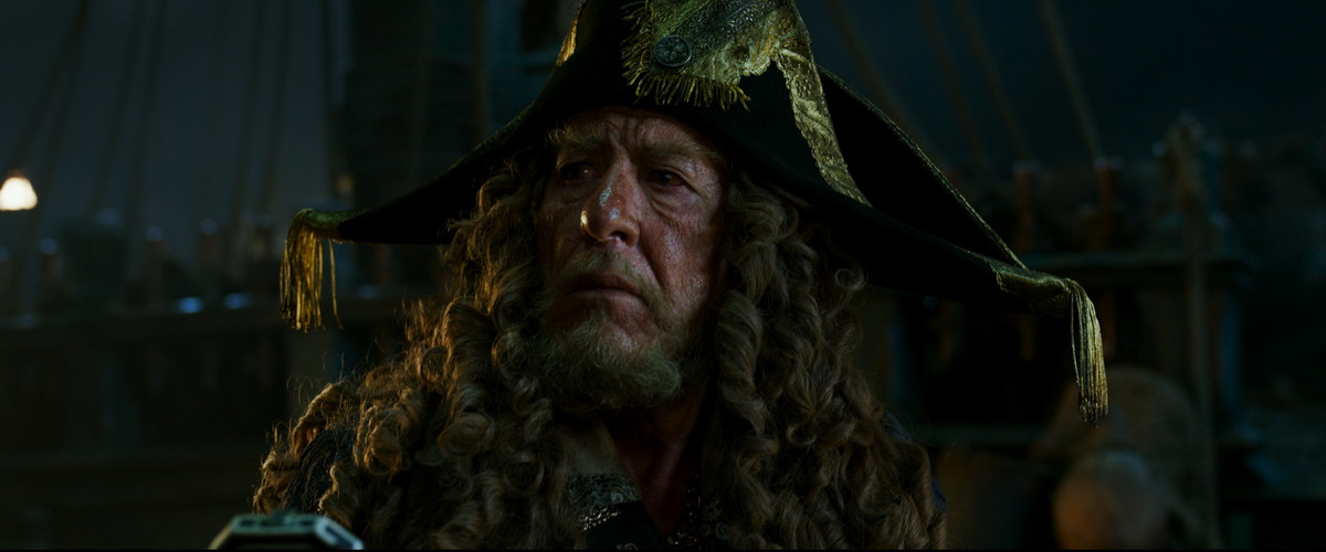 Captain Barbossa (Geoffrey Rush) looks off into the distance