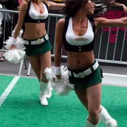 The New York Jets cheerleaders perform outside Saks. Photo by Anna Fischer.