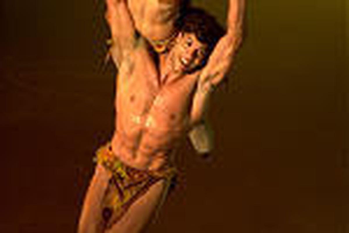 "Tarzan (Stephane Morel) and Jane (Robin Johnstone) in ""Disney on Ice: 3 Jungle Adventures"" at the Delta Center."